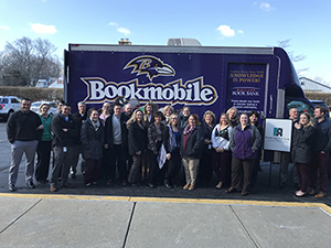Harford Mutual Employees in front of the Bookmobile.